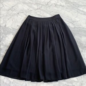 WHBM lined black chiffon pleated mid length skirt